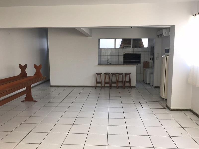 Salão de festas equipado com churrasqueira