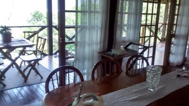 7. Sala com linda vista para a Lagoa da Conceição