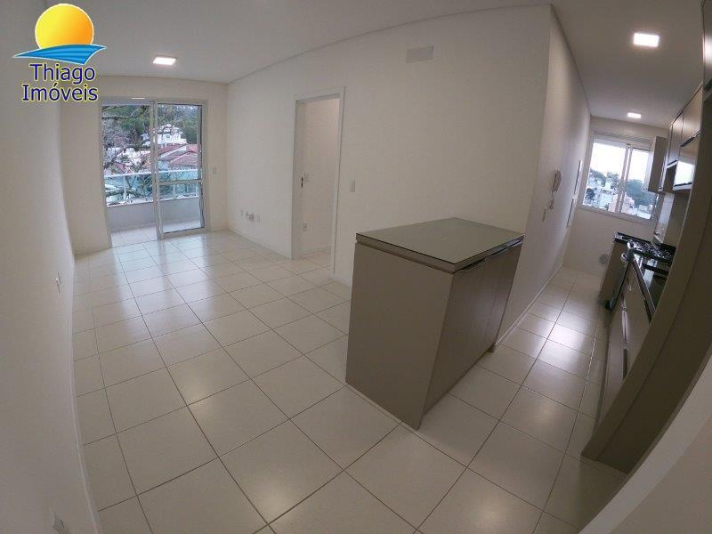 Apartamento com o Código 10001887 para alugar no bairro Canasvieiras na cidade de Florianópolis com 2 dormitorio(s) possui 2 garagem(ns) possui 2 banheiro(s) com área de 63,03 m2